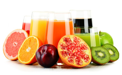 Glasses of assorted fruit juices isolated on white. Detox diet