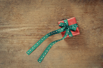 small cute present box for Christmas on old wooden background