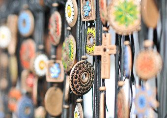 Various necklaces at souvenir market in Romania, close up