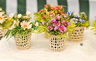 Colorful artificial flowers decorations. Decorative arrangement