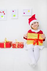 girl with  christmas gifts