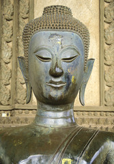 half body Ancient Buddhism statue in Laos Temple