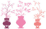 set of vases with pink spring flowers