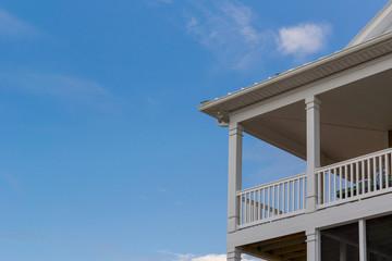 Verando porch set against a blue sky
