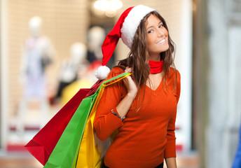 Beautiful woman doing Christmas shopping