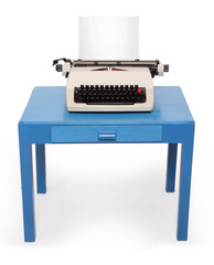 Retro style typewriter with paper on office desk.
