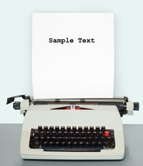 Retro style picture of old typewriter with paper.