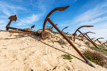 Cemetery of anchors on the beach at Praia Do Barril in Santa Luz