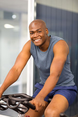 african american man sitting on a stationary bike