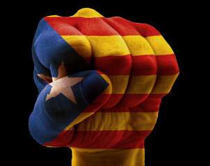 Catalonia flag on fist isolated on black