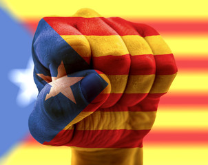 Catalonia flag on fist with Catalonian flag in background