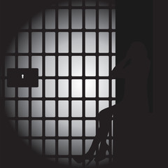 Silhouette of a Women in a Dark Jail Cell