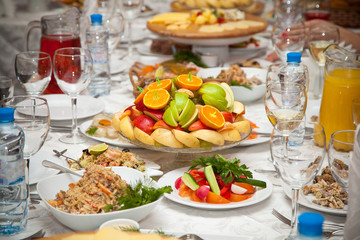 fruits and salads on the holiday table in the restaurant