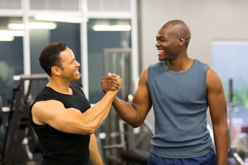 men handshaking in gym
