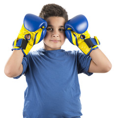 Little boy wearing blue boxing gloves