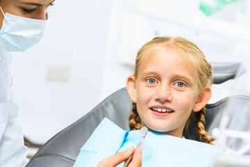 Dentist inspecting patient
