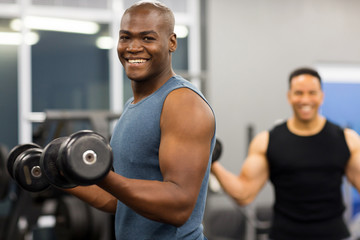 african man working out with dumbbells