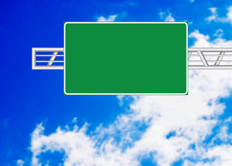 Highway sign over blue sky