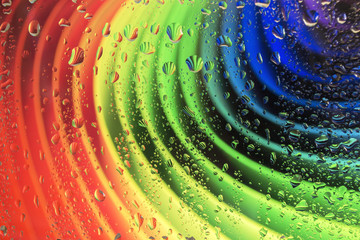 Rainbow consists of cardboard and raindrops on glass