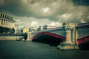 Vintage toned Black Friars Bridge over the Thames in London