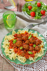 Pasta with mini meatballs with tomato sauce