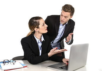 woman working at computer arguing with work colleague in stress