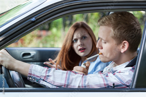 Couple argue over car smoking - 73589217