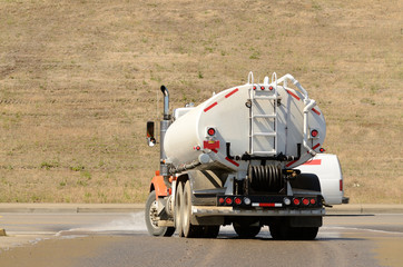 Large tank truck working at a construction site
