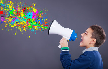 child yells into a megaphone,splattered colors exiting from him
