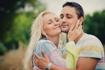 young man hugging his darling woman