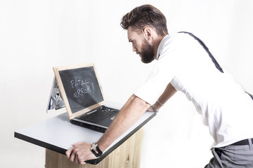 young businessman has problems with computer