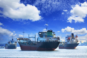 oil and industrial tanker transport ship floating on river port