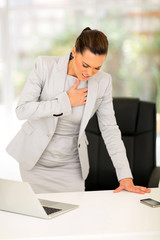 young businesswoman having heart attack
