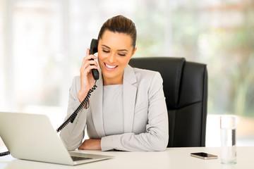 businesswoman using landline phone