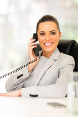corporate worker talking on telephone