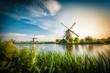 Leinwanddruck Bild - Historians Dutch windmills near Rotterdam