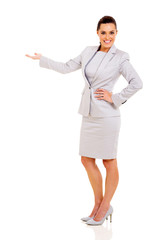 young businesswoman doing welcome gesture