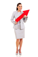 businesswoman holding red arrow