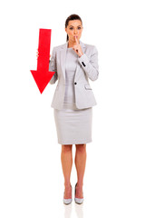 businesswoman with finger on her lips gesturing for quiet