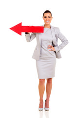 businesswoman with red direction arrow
