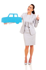 businesswoman holding blue car symbol