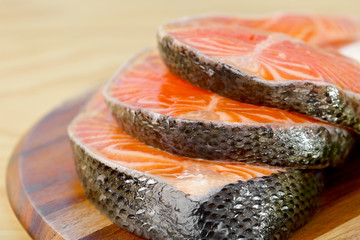 Delicious  portion of fresh salmon fillet on a wooden board
