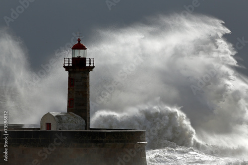 Huge wave over lighthouse - 73596832