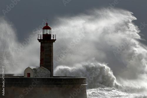 Huge wave over lighthouse - 73596832