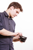 Young man paying by credit card spending money. Finance. poster