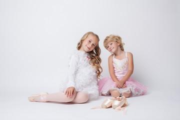 Lovely little ballerinas posing in studio