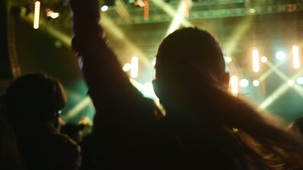 People dancing at open air rock festival