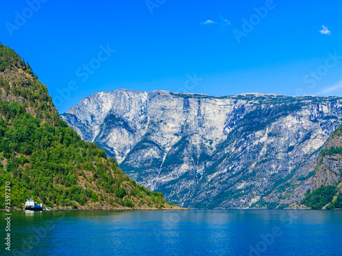 Tourism and travel. Mountains and fjord in Norway. - 73597270