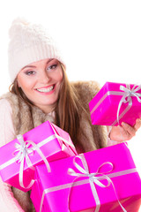 girl in warm winter clothes with many pink gift boxes