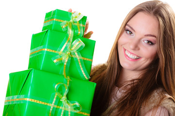 girl with many green gift boxes isolated